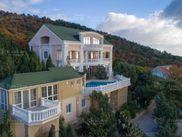 Купить дом с участком по адресу Крым, г. Ялта, пгт Гаспра, Безымянная ул.
